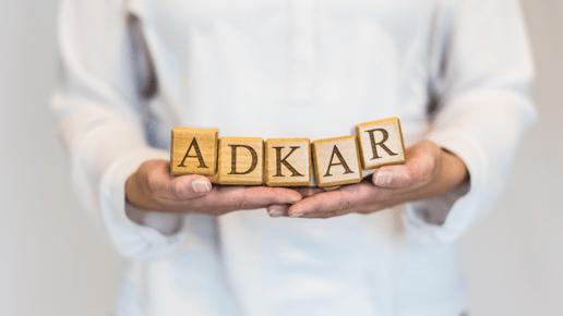 adkar-model-blocks-on-man-hands