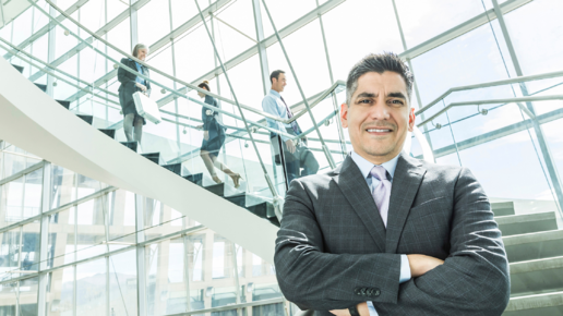 business-man-standing-in-front-of-stairs